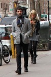 They both look great, his: classic grey blazer, plaid scarf & 5 o'clock shadow. her: jersey layers with motorcycle jkt & floppy boots