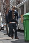 Sweatshirt with toggles, nice shoes; he cares - but not too much. ;)