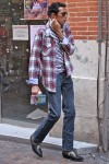 plaid button down, stripe shirt, skinny jeans and cowboy boots.  yes.